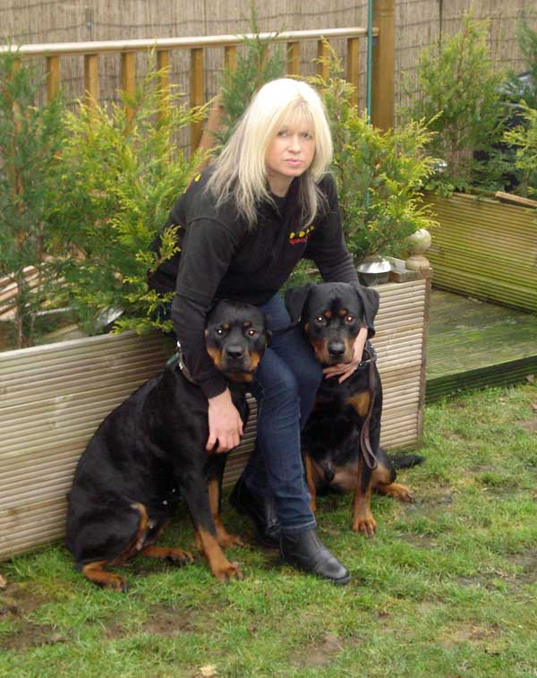 Anita Foster with her two Rottweillers